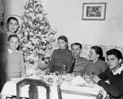 A Goudas Family Christmas, Kalamaki, Athens, Greece.  Spyros Peter Goudas is to the left of the Christmas Tree.Σπύρος Πήτερ Γούδας
