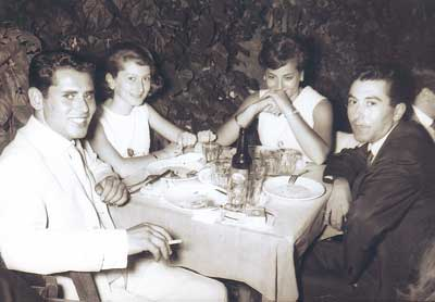 Spyros Peter Goudas, Nana Valatsos, Marina (his sister),and Nikos Valatsos. (In a few words, two brothers and two sisters having a friendly dinner